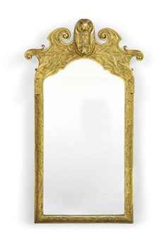 AN EDWARDIAN GILTWOOD AND GESSO WALL MIRROR IN THE GEORGE II STYLE