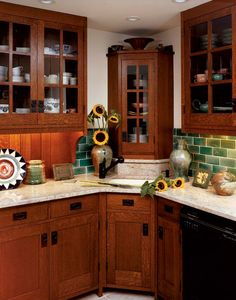Looking to Stickley furniture for inspiration, the owners of this 1930 bungalow gave their kitchen an Arts & Crafts makeover with quarter-sawn-oak cabinets and a Grueby green tile backsplash. (Photo: Rob Gray)