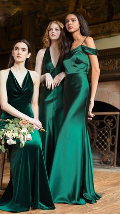 Jenny Yoo Collection 2018 Bridesmaids, featuring an emerald green  bridal party. The Corrine dress features a plunging V halterneck for  drama. The back features an eyecatching wrapped strap detail. The slim  bias cut skirt highlights the body's femininity with glamorous shine. The satin back crepe Serena Dress features a pleated cowl neck for a  romantic detail and off the shoulder sleeves.The Sullivan dress features  a soft cowl with a halter neckline and razor back detail. Photo by…