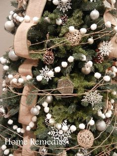 Find out how to make your own DIY Cotton Ball Pom Pom Garland - from HomeRemediesRx.com