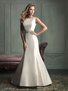 Perfectly seamed for a flattering fit, this gown is composed of sculpted satin and features a sophisticated bateau neckline, as well as a gem encrusted waistband.  Sizes:2 - 32 Colors:White/Silver, Ivory/Silver, Champagne/Silver Fabric:Taffeta