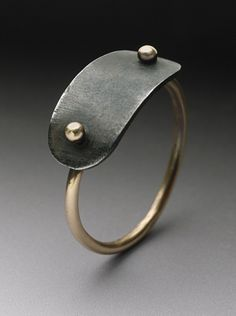 Plate Ring: Peg Fetter: A thin-banded 14k yellow gold ring, topped with an oxidized steel plate.  $240.00
