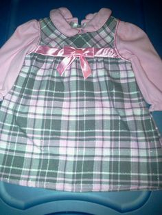 Youngland newborn-6-9m. 2pc dress in Tiny_Treasures' Yard Sale Hartsville, TN for $5.00. Pretty pink, gry, whi, glittery dress w bow. Great for church or special event.