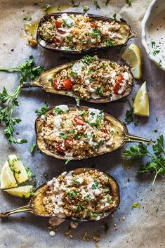 Couscous Stuffed Eggplant topped with a fresh Lemon Tahini Sauce is a delicious way to serve eggplants. Vegan and Dairy-Free! #couscous #eggplant #vegan