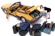 Loading the trunk on a Saab 900 convertable