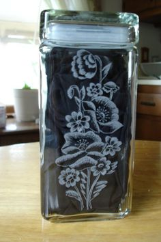 Flowers engraved on the back of a jar.