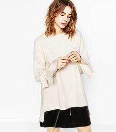 LIGHT WHITES Brighten up your wardrobe this season with a variation of white and cream-colored basics ranging from sweaters to tailored trousers. Zara Sweater With Tie Sleeves ($50)