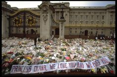 Flowers were left in tribute outside of both Buckingham Palace and Kensington Palace in tribute to Princess Diana - TownandCountrymag.com