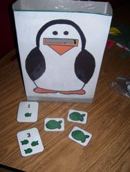 penguin artic therapy...tweak for speech.  cut and laminate drill cards on cardstock, and feed the animal!
