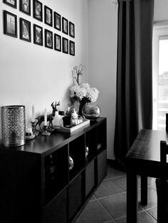Dinning area with black-brown Ikea Expedit/Kallax as a console. Grey curtains and small pictures display using cheap Ikea frames.  #Decoration #EasyDecor #OnABudget #MixAndMatch #Ikea #Kallax #Expedit #Console #Dinning