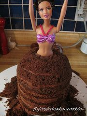 The Frosted Cake n' Cookie - Great tutorial on making a doll/Barbie cake. She uses fondant, but I would use buttercream.