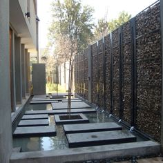 Perfect new wall for the south fence.   Gabion Walls - What They Are And How To Use Them In Your Landscape