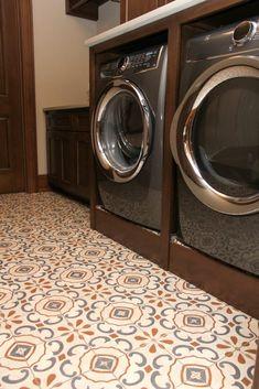 White blue and orange patterned laundry room tile floor Laundry Room Colors, Laundry Room Tile, Hardwood Floors, Flooring, New Carpet, Stacked Washer Dryer, Backsplash, Tile Floor, New Homes