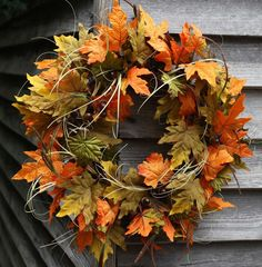 Simple Thanksgiving decor . . . not a wreath necessarily, but the leaves and grass mix for the table, chandelier, etc.