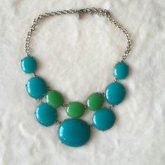 Blue and Green Statement Necklace Green and aqua blue fashion statement necklace. Beads are plastic. New York & Company Jewelry Necklaces