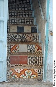 Reclaimed encaustic tiles on a staircase in south America. We have many such tiles in stock, in Sydenham!