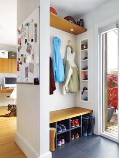 Instead of opting for a space-hog mudroom, create a customized entryway with space-efficient shelving and storage. #organization