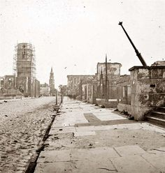 Charleston, South Carolina 1865. Meeting Street, looking south, showing St. Michael's Church, the Mills house, ruins of the Circular Church