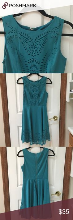 "✨NWT✨Teal laser cut dress. Brand new teal fit 'n' flare dress with laser cutout detail on front bodice and bottom hem. Zipper back closure. Lined. 15.5"" bust, 13"" waist, 36"" length. This one is stunning in person! ModCloth Dresses"