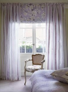 patterned shade with sheer curtains