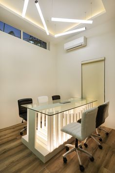 The drama of lines and lights made in solid acrylic surfaces(corian) for conference table highlights the contemporary style of conference room by A.J Architects. Conference Table, Corian, Contemporary Style, Architects, Highlights, Drama, Interior Design, Furniture, Home Decor