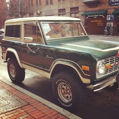 Old school Bronco! Love the paint job on this one!