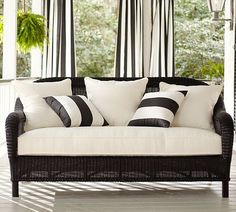 black and white patio furniture. I love the black and white striped pillows!