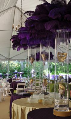 Feathered Centerpieces. Great for height. Or, could do lower to the table with large balloon.