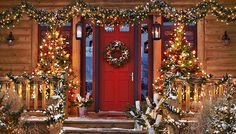 Log house front porch with Christmas decorations.