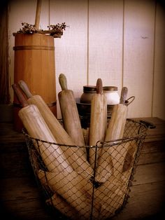 Large Farmhouse Naturally Rusted Wire Primitive Chicken Wire Style Gathering Basket and rolling pins via SHABBY HAPPY on Etsy...