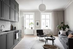 The subtile color palette of this minimal and stylish home really speaks to me. The very light grey walls in the entire apartment combine very nicely with the beige linen curtains*, darker grey of the kitchen cabinets and the light … Continue reading → Relax, Light Grey Walls, Loft, Linen Curtains, Interior Stylist, Grey And Beige, Spotlights, Modern House Design, Scandinavian Style