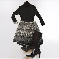 NWT White House Black Market pretty skirt. Never worn, new with tags. Gorgeous silk black and cream print skirt from White House Black Market. Has unique pleated cut all around. Great movement. Lined, side zip. Listing is for skirt only! White House Black Market Skirts Mini