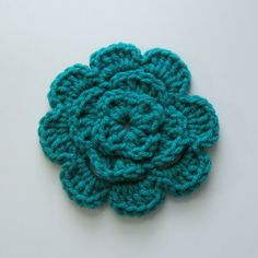 Crochet Flowers Design Easiest Headwrap Ever - Welcome everyone! I needed to work up a headwrap super fast and couldn't find an easy basic pattern so I've decided to type up my own! I just recently worked up this flower and thought … Crochet Puff Flower, Crochet Flower Patterns, Crochet Motif, Crochet Designs, Crochet Flowers, Hat Patterns, Free Crochet, Crochet Fish, Crochet Stitches