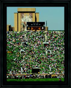 Touchdown Jesus at Notre Dame Stadium. We need more touchdowns on the field; there are enough on the library.