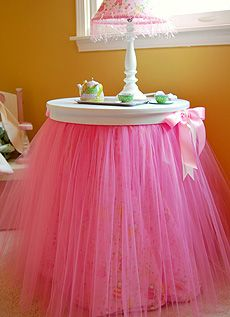 What a stunning addition to your little ballerina's room! This table topper will turn your small round 3 legged table into a gorgeous, fluffy ballerina skirt. The birch wood round is painted white with an attached tulle skirt and 2 satin bows, one on each side. Choose from Paris pink, lavender, or celadon green and just place the 24″ topper on your round table for instant pizazz!
