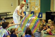 Introducing the Great Big Ball to the class.      Hi from Miss Carole  at Macaroni Soup: Active Music for Kids!   In 24 years of t...