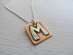 Personalized Initial necklace hand cut in sterling silver and copper $50.00 by JoDeneMoneuseJewelry