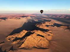 A Namib Sky Balloon Safaris excursion on the Kulala Wilderness Reserve offers a truly unique experience to soar silently above the magnificent Sossusvlei dunes of the Namib Desert, with a champagne breakfast awaiting you at the landing site. Africa Travel, Us Travel, Champagne Breakfast, Balloon Flights, Namib Desert, Dune, Wilderness, Landing, Grand Canyon