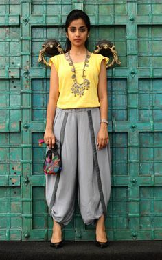 'Desi – Pardesi Cocktail' from the Char Avatar series featuring Paulami's Kantha Potli (priced at INR 1850) A TEE from the west + a DHOTI from the east = a great COCKTAIL for an indo western outfit. As the kantha potli is already very playful with the colours we used a happy bright yellow tee to compliment the palette. Heavy accessorising can make the look go from simple to glam.