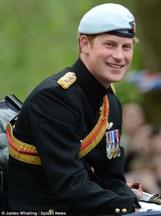 Special moment: Prince Harry grinned from a carriage in military garb