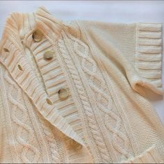 """Michael Kors short sleeve cardigan NWOT New without tags cozy and chic cardigan, cream color , MK signature buttons, very soft and spacious, fits XS/S/ M, 21"""" wide, 26"""" long, very beautiful sweater. Michael Kors Sweaters Cardigans"""