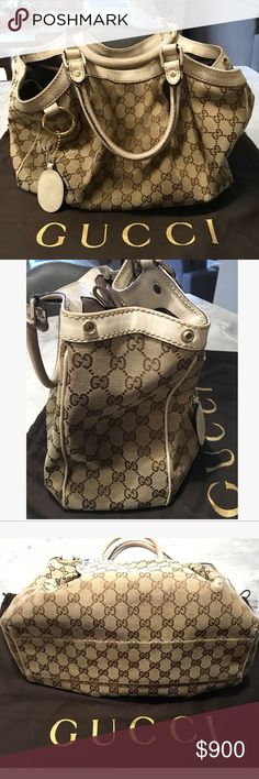 GUCCI Monogram 'Sukey' Tote-medium 100% Authentic GUCCI 'Sukey'Tote. Comes with original Gucci cloth bag protector and Gucci logo charm. Classic brown and beige GG monogram canvas with off white leather trim. Great for everyday. It is gently used and bag shows signs of rubbing on fabric from normal everyday use. Still looks great and has tons of life left! It is a timeless bag. Email me for more pictures and info if interested.. Would be happy to answer you...laurynbnovak@gmail.com handle…