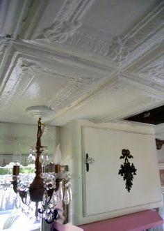ceiling tiles, door hardware, and chandelier in this vintage Shasta!