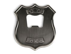 Police badges modified into beer bottle openers