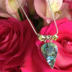 """925 Silver Abalone & Peridot 16"""" Necklace 925 Silver Abalone Shell & Peridot 16"""" Necklace Hallmarked 925 Total Weight-7.4 grams Pendant Length-1 1/2"""" ONE-OF-A-KIND! One-of-a-Kind Jewelry Necklaces"""
