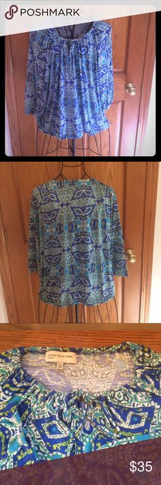 Jones of New York Top Keyhole blouse with tie detail. Elastic neckline, arms and on bottom. 3/4 sleeves. 100% viscose. Beautiful print! Jones New York Tops Blouses