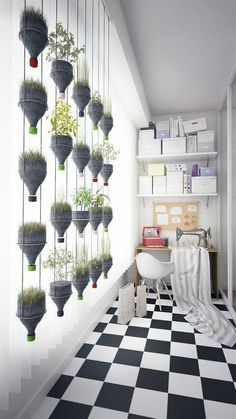 Vertical Gardens Modern Hanging Plants Wall from Recycled Plastic Bottles Recycled Plastic - This wall of hanging plants looks very modern and design and the best.it was done with recycled plastic bottles. Hanging Potted Plants, Hanging Plant Wall, Indoor Plants, Diy Hanging, Air Plants, Hanging Herbs, Hanging Gardens, Hanging Flowers, Wall Of Plants