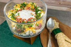 This Simple Seven-Layer Potato Salad is great for the baked potato lover in all of us. Made like a deconstructed version of your favorite baked spud, this easy potato salad recipe is the ultimate dish for summer potlucks.
