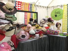 Hat side of the booth by Sayra Adams, via Flickr.  I am still looking for the perfect way to display my hat collection!