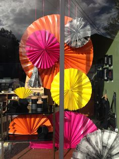 Tilde spring windows - folded bright paper! I am so doing this for my front window #home